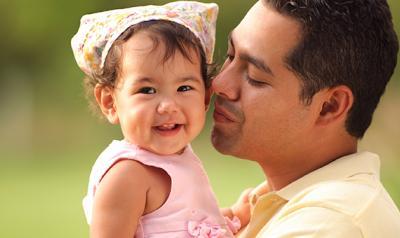 Dad singing to daughter