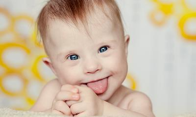 Infant sticking tongue out at camera