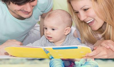 Parents reading to a baby