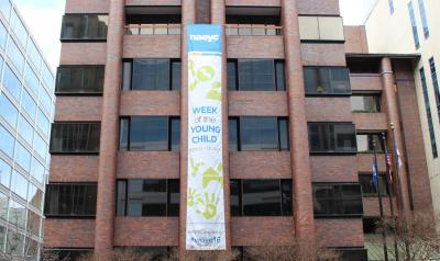 NAEYC headquarters with WOYC banner