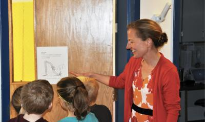Teacher showing students an illustration