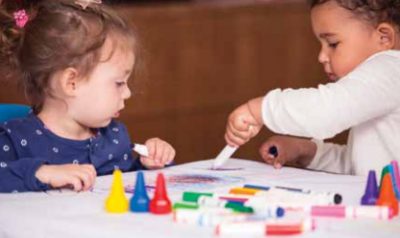 Preschoolers color together