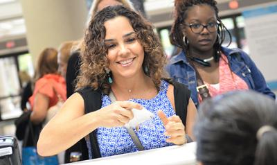 Women register for a NAEYC conference.