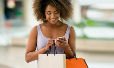 Woman shopping and looking at her cell phone