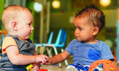 infants holding hands - Young Children Pictures