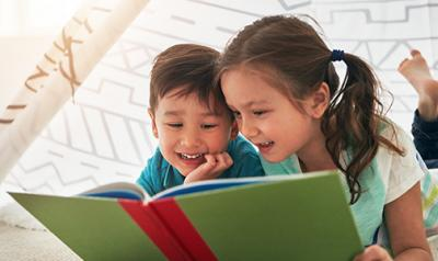 Two children reading with each other.