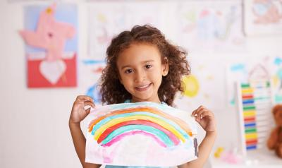 Child holding a drawing