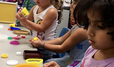 Children in a classroom playing with playdough