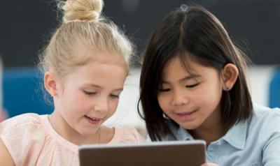 Two girls looking at a screen