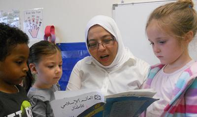 Teacher reading a book to sutdents