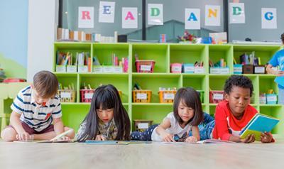 Children reading books on the floor