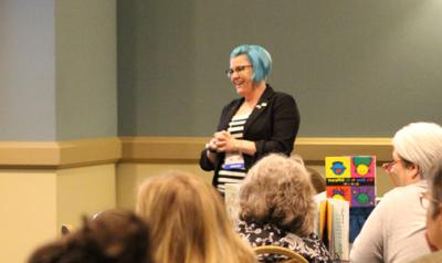 Photograph of a female presenter at Annual Conference.