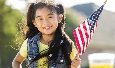 Young girl holding American flag