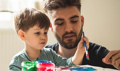 a parent painting with a child