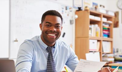 A professional sitting in a classroom