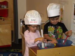 children play baking in classroom