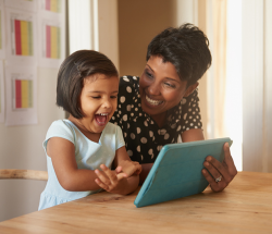 Mother and daughter with ipad/tablet