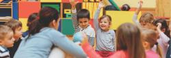 Preschool children in circle in classroom