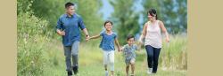family of four walking oputdoors