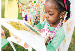 Girl painting on a canvas