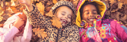 Three girls playing in leaves
