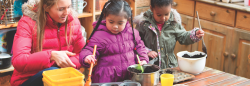 Teacher and students with mud kitchen