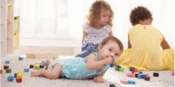 Group of toddlers playing with blocks on the floor
