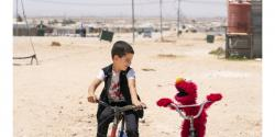 boy with Elmo in Syria