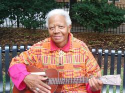 Ella Jenkins playing a guitar