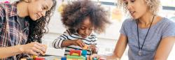 Young girl plays with blocks.