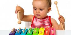 Baby playing on a xylophone