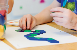 Child playing with shapes