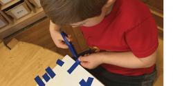 Boy cutting tape