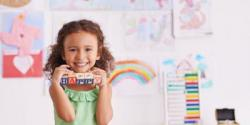 preschool girl holding blocks