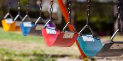 empty swing sets on a playground