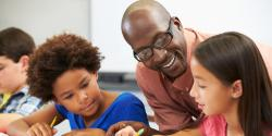 a teacher overseeing two children