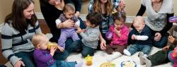 Parents sitting in half circle with toddler children