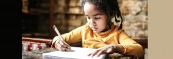 Child writing on paper