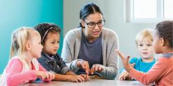 a teacher talking to a group of children