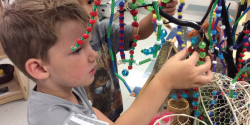a child playing with beads
