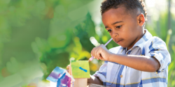 a child painting a craft project