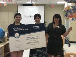 Kiddie Academy staff and NAEYC Accreditation team pose for a picture with accreditation certificate.