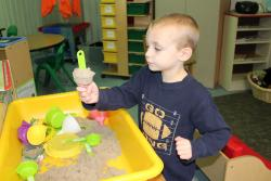 Boy playing in sand table