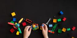 young child playing with legos