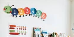a paper caterpillar wall decoration in classroom