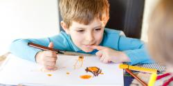 A young child drawing