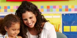 Mother and daughter in a classroom smiling