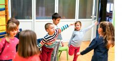 Young children in a classroom exercising