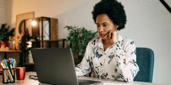 Woman at a computer staring at a screen