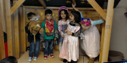 A group of young children dresses up for their stage production.